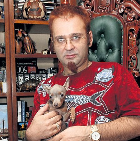 У отца Романа остались только фотографии сына с пёсиком. Фото: «PhotoXPress»